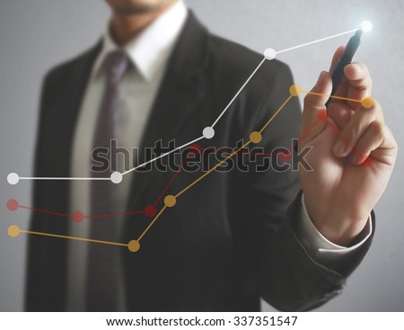 businessman drawing graphics a...