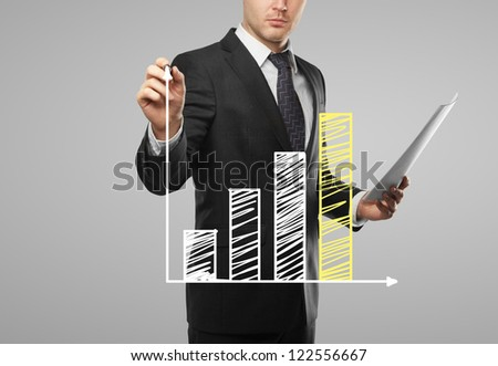 businessman drawing growth of chart