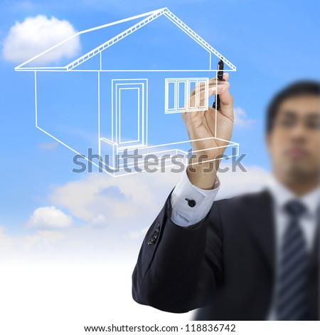 Businessman drawing house