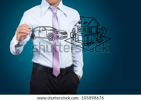 Businessman drawing house and car in a whiteboard.