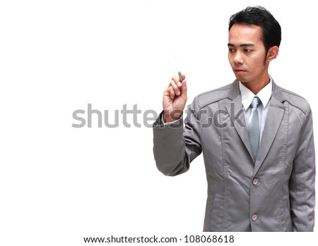 businessman drawing in a transparent glass, isolated on white background