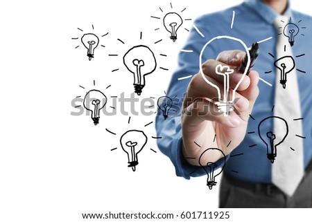 businessman drawing light bulb...
