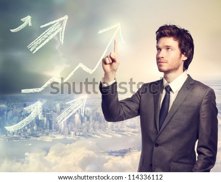 Businessman drawing rising arrows on top of the city