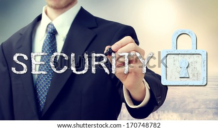 Businessman drawing security text and key lock concept