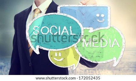 Businessman drawing Social Media colorful speech bubbles