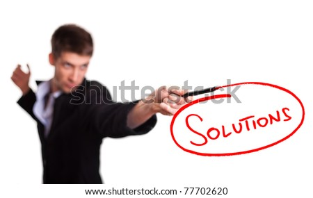 Businessman drawing solutions on whiteboard (selective focus) - stock photo