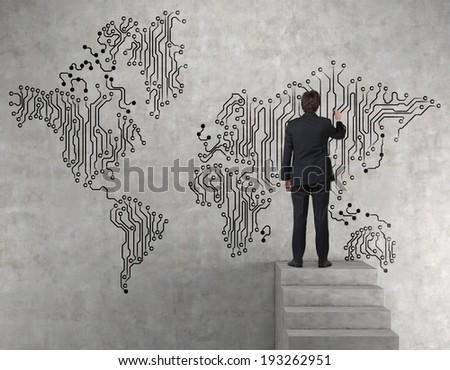 Businessman drawing the map