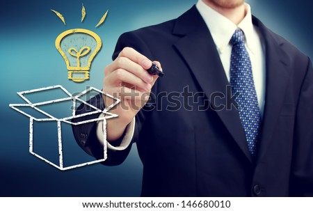 Businessman drawing thinking outside the box theme