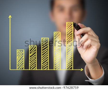 businessman drawing upward trend bar chart