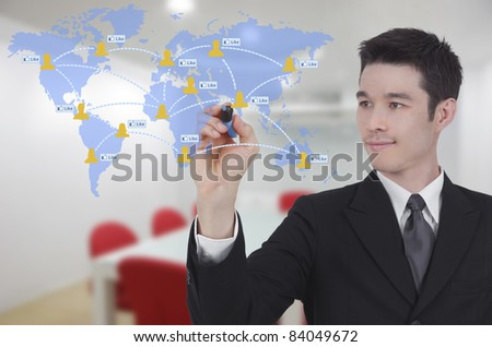 businessman drawing world map and social network with like button in conference room