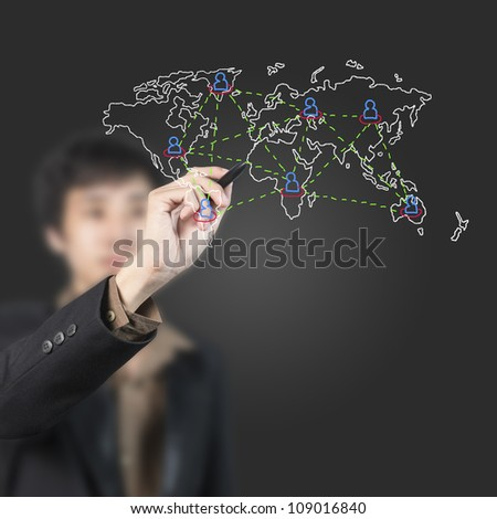 Businessman drawing world map on white board