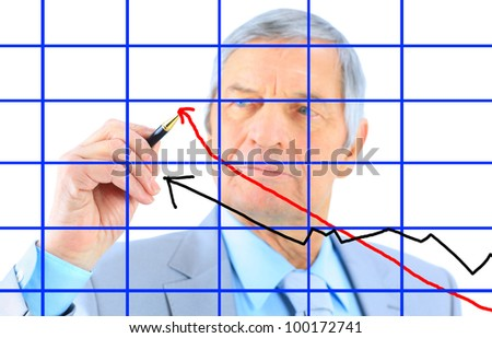Businessman draws a graph. Isolated on a white background.