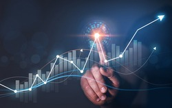 Businessman draws chart financial goals and economic business. Business strategy development and growing growth plan.
