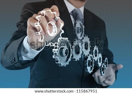 businessman draws gear to success concept