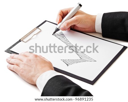 Businessman draws large checkmark on paper on clipboard; achievement or success concept; focus on tip of the pen