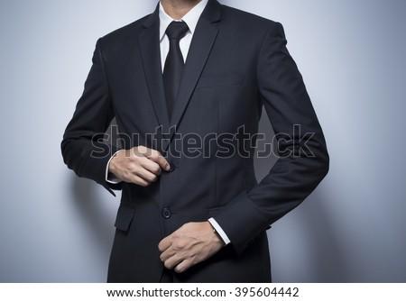 Businessman Dressing Up a Black Suit Stock photo ©