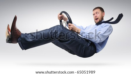 Businessman driver with open mouth in a tie with a wheel concept