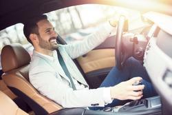 Businessman driving a car.
