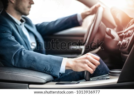 Businessman driving a sportive luxury car #1013936977
