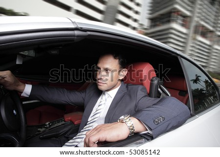 Businessman driving in his luxury automobile