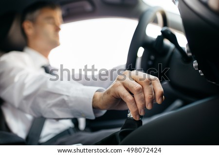 Businessman driving to work, hand shifting the gear stick Stock photo ©