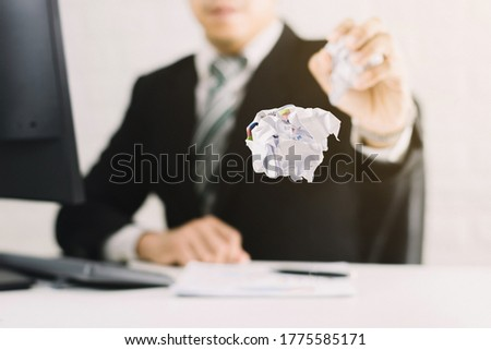 businessman emotions and fail concept crumpled paper on table with, unhappy no idea to thinking throwing papers in office Сток-фото ©