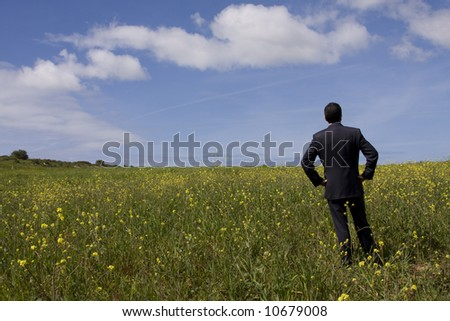 businessman enjoying the nature and planning the future