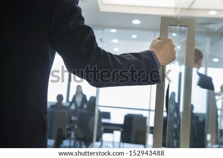 Businessman Entering an Office