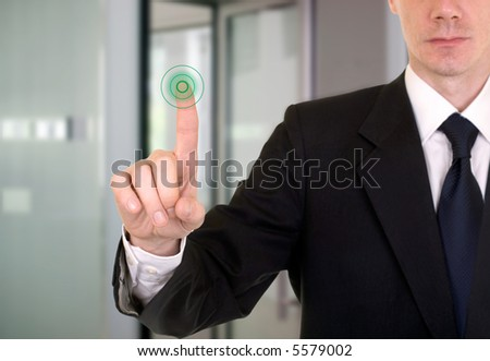 businessman entering the bank or secure data by touch screen