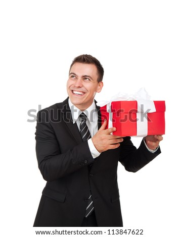 Businessman excited happy smile hold gift box in hand. Business man present red gift box with ribbon bow Isolated over white background