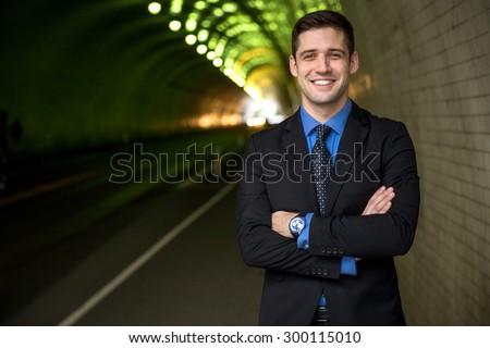 Businessman executive portrait arms crossed interesting background headshot