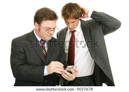 Businessman explaining something to confused young protege.  Isolated on white.