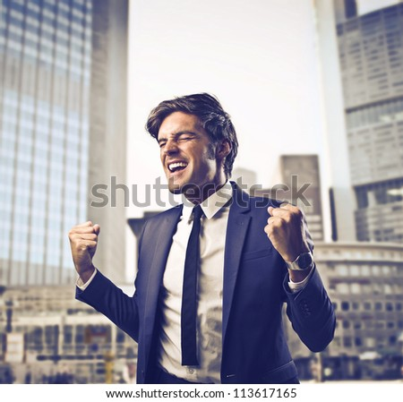 Businessman exulting for his success