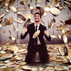 Businessman exults under a rain of money