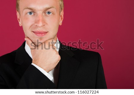 Businessman face on a red background. Closeup