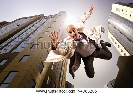 Businessman falling from a tall building