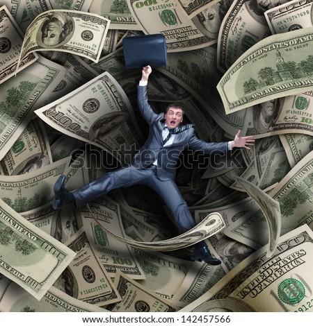 Businessman falling into tunnel of $100 dollar bills