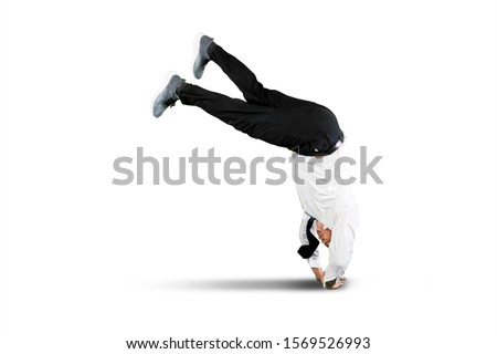 Businessman falling over isolated over white background