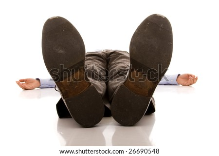 businessman feet of a dead body (isolated on white)