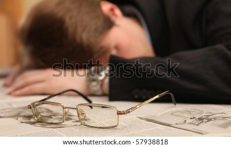 businessman fell asleep at work