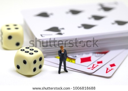 Businessman figure and table game accessories. Poker with dice. Poker hand. Gambling game and player. Table game with card desk and dice. Cheating in card game. Winning strategy or luck. Chance to win #1006818688