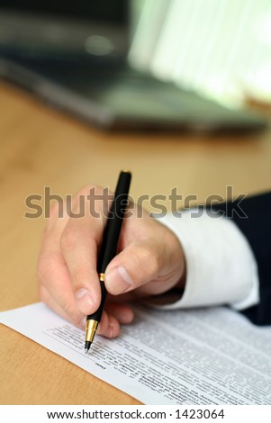 Businessman filing out a form