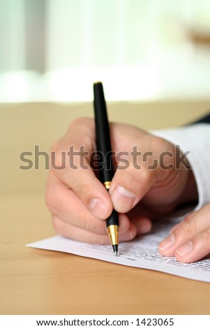 Businessman filing out a form - stock photo