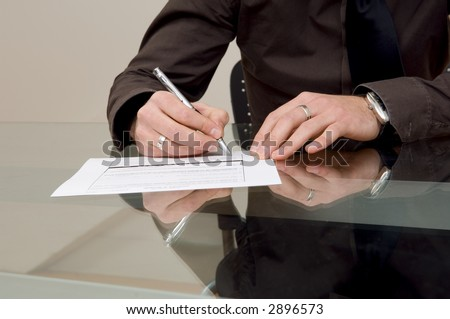 Businessman filling out paperwork.