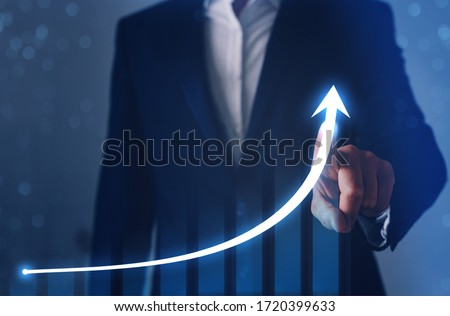 Businessman finger pointing arrow graph. Business development to success, profit and growing  plan.