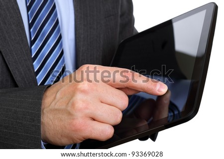 Businessman finger touching screen on tablet-pc