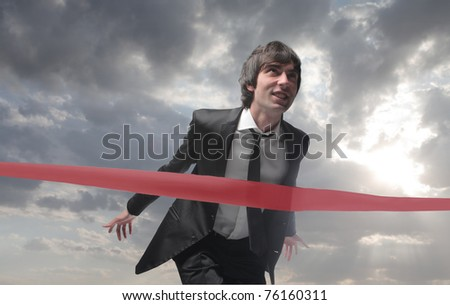 Businessman finishing a race