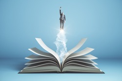 Businessman flies over open book on blue background. Business and education concept.