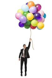 Businessman flying high concept of success