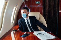 Businessman flying on his private jet. Concept about business, and transportation
